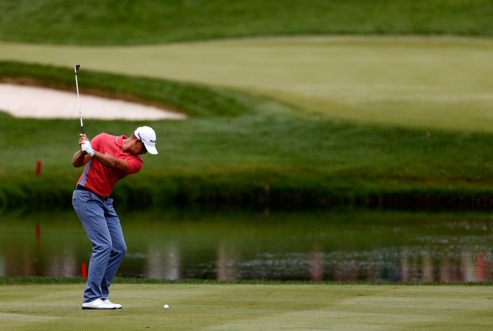 . Henrik Stenson of Swedenhits off the third fairway during the Final Round of the World Golf Championships-Bridgestone Invitational at Firestone Country Club South Course on August 4, 2013 in Akron, Ohio.  (Photo by Gregory Shamus/Getty Images)