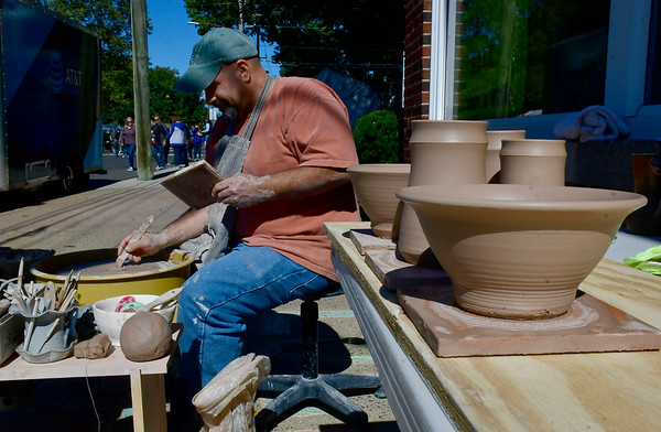 10/5/2019 Mike Orazzi | StaffrRobert Riggs demonstrates the art of making pottery while at the 51st Annual Apple Harvest Festival in Southington on Saturday.