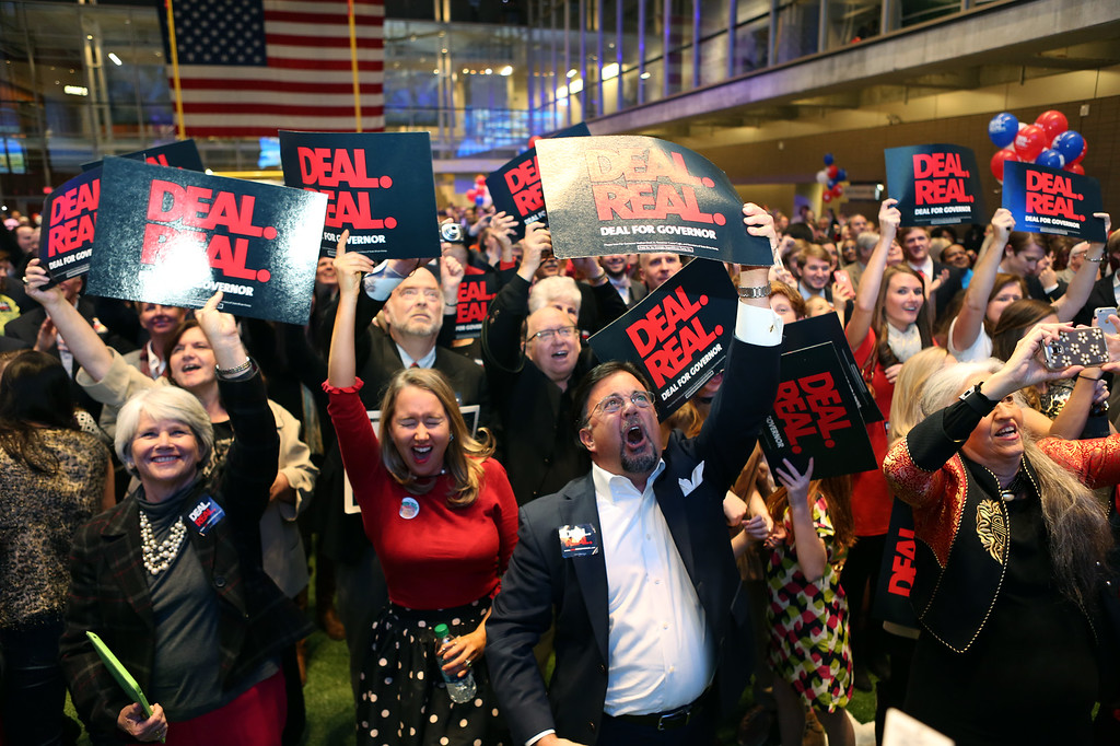 . The crowd reacts to the news Jason Carter has conceded defeat to incumbent Georgia Gov. Nathan Deal at the College Football Hall of Fame in Atlanta, Tuesday, Nov. 4, 2014. (AP Photo/Akili-Casundria Ramsess)
