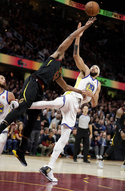 . Golden State Warriors\' JaVale McGee and Cleveland Cavaliers\' Tristan Thompson reach for the ball during the second half of Game 3 of basketball\'s NBA Finals, Wednesday, June 6, 2018, in Cleveland. (AP Photo/Tony Dejak)