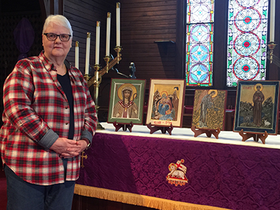 Dottie Brown displays her religious icon paintings.