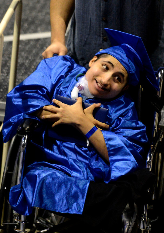 . Christian Butanda, 19, of Rialto, reacts after receiving his diploma during Rialto High School Commencement Exercises held at Citizens Bank Arena in Ontario June 2, 2013. GABRIEL LUIS ACOSTA/STAFF PHOTOGRAPHER.