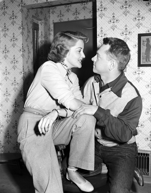 . Actress Martha Vickers and Actor Mickey Rooney cast adoring eyes on each other, at Vicker\'s home in North Hollywood, Calif., on March 7, 1949. The couple is engaged, however the bride will not be free to wed until late summer when her divorce from publicist A.C. Lyles is final.  (AP Photo)