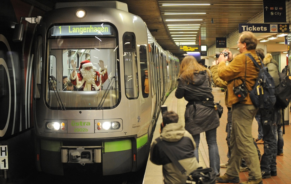 Description of . Photographers gather to take pictures of metro driver Rolf Mitschker dressed as Santa Claus on December 23, 2008 at a station in Hanover, central Germany. Mitschker will wear his dress also during his shift on Christmas, December 24,      AFP PHOTO    DDP/NIGEL TREBLIN