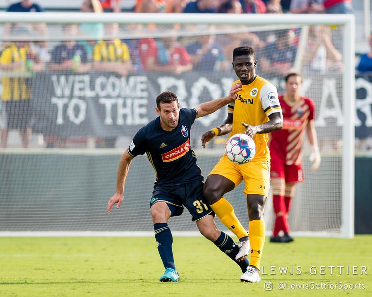North Carolina FC defender Steven Miller (31) and Nashville SC forward Ropapa Mensah (3)