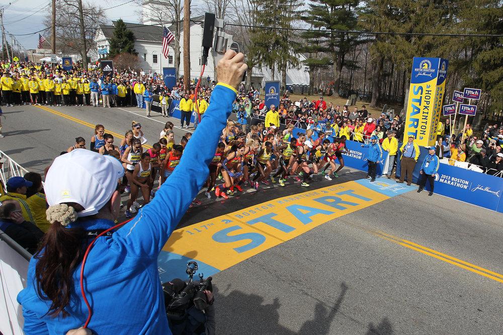 . Jacqueline Benson shoots the starting piston for the elite womens\' start of the 117th running of the Boston Marathon, in Hopkinton, Mass., Monday, April 15, 2013. (AP Photo/Stew Milne)
