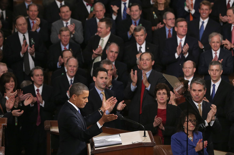 ". U.S. President Barack Obama delivers his State of the Union speech before a joint session of Congress at the U.S. Capitol February 12, 2013 in Washington, DC. Facing a divided Congress, Obama focused his speech on new initiatives designed to stimulate the U.S. economy and said, ""It�s not a bigger government we need, but a smarter government that sets priorities and invests in broad-based growth\"".  (Photo by Alex Wong/Getty Images)"