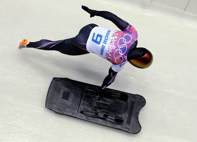 . John Daly of the United States starts his first run during the men\'s skeleton competition at the 2014 Winter Olympics, Friday, Feb. 14, 2014, in Krasnaya Polyana, Russia. (AP Photo/Michael Sohn)