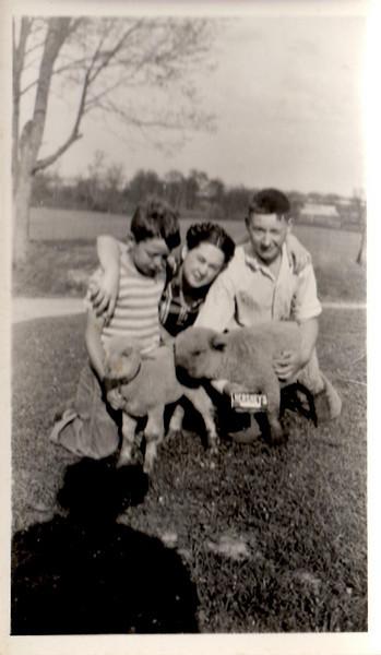 Mom with Paul and John on the farm. Is John holding a Hershey bar??