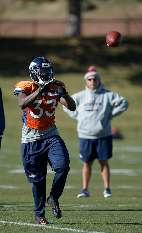 . Denver Broncos strong safety Duke Ihenacho (33) catches a pass during drills at practice November 20, 2013 at Dove Valley (Photo by John Leyba/The Denver Post)