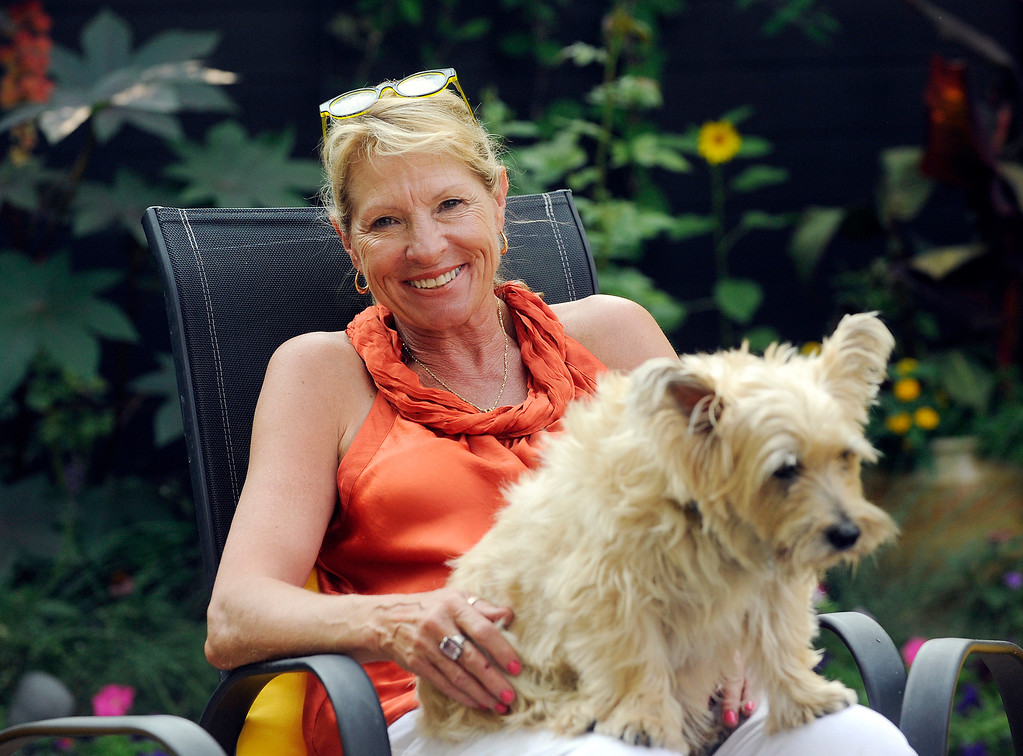 . When she was a high school senior, Becky Peters-Combs included among her life goals having a tropical garden. With the ponds, she\'s created one for her family - including Melvin, one of their two dogs - to enjoy. (Cyrus McCrimmon, The Denver Post)