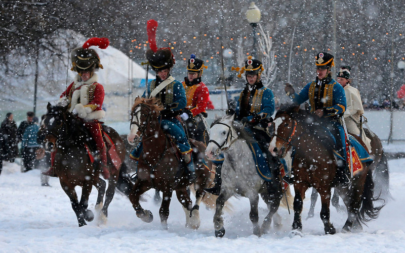 . Historical re-enactors dressed as 1812-era French horsemen ride during a reenactment of the French Invasion of Russia in 1812, during celebrations to mark the Russian Orthodox Christmas in St.Petersburg, Russia, Monday, Jan. 7, 2013.  Christmas falls on Jan. 7 for Orthodox Christians who rely on the old Julian calendar rather than the  Gregorian calendar adopted by Catholics and Protestants and commonly used in secular life around the world. (AP Photo/Dmitry Lovetsky)