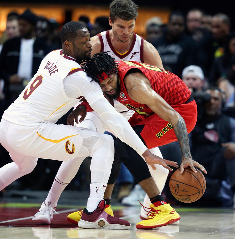 . Cleveland Cavaliers guard Dwyane Wade (9) reaches in to try to steal the ball from Atlanta Hawks forward DeAndre\' Bembry (95) in the second half of an NBA basketball game Thursday, Nov. 30, 2017, in Atlanta. Cleveland won 121-114. (AP Photo/John Bazemore)