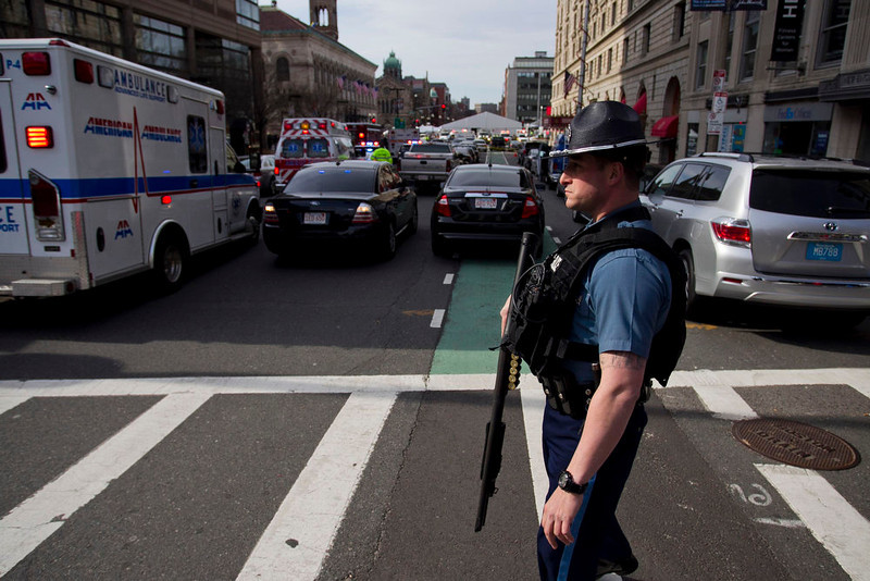 . A Massachusetts State Police officer stands guard at the scene after explosions reportedly interrupted the running of the 117th Boston Marathon in Boston, Massachusetts April 15, 2013. Two explosions hit the Boston Marathon as runners crossed the finish line on Monday, killing at least two people and injuring 23 on a day when tens of thousands of people pack the streets to watch one of the world\'s best known marathons. REUTERS/Dominick Reuter