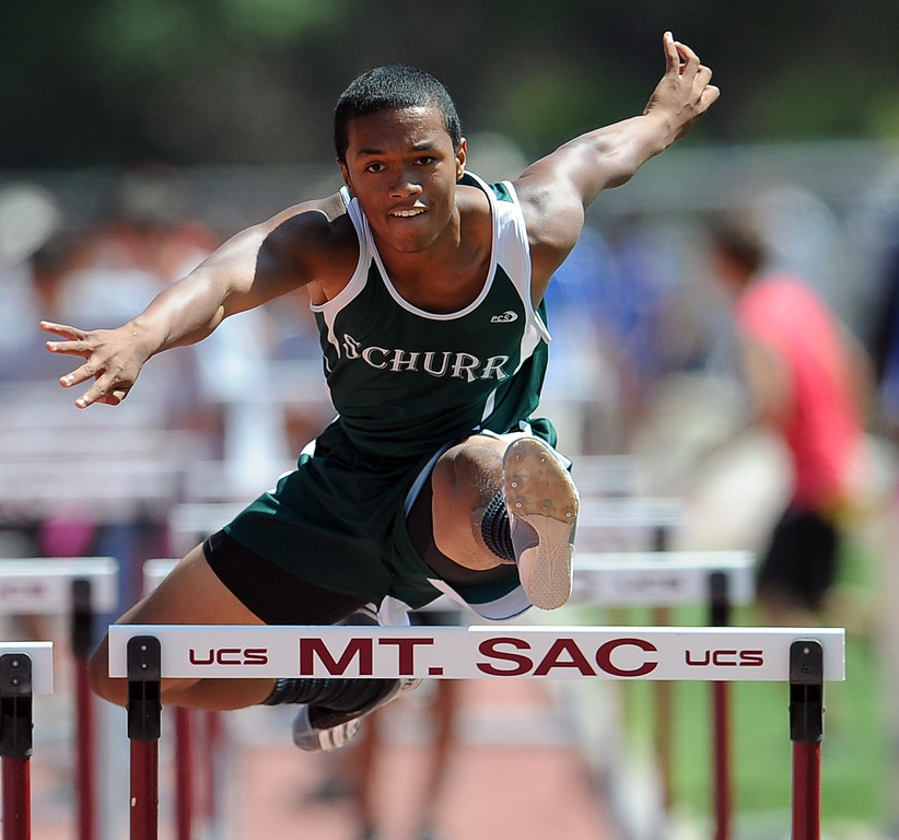 . Schurr\'s Dario Robinson in the 100 meter high hurdles during the CIF-SS track & Field championship finals in Hilmer Stadium on the campus of Mt. San Antonio College on Saturday, May 18, 2013 in Walnut, Calif.  (Keith Birmingham Pasadena Star-News)