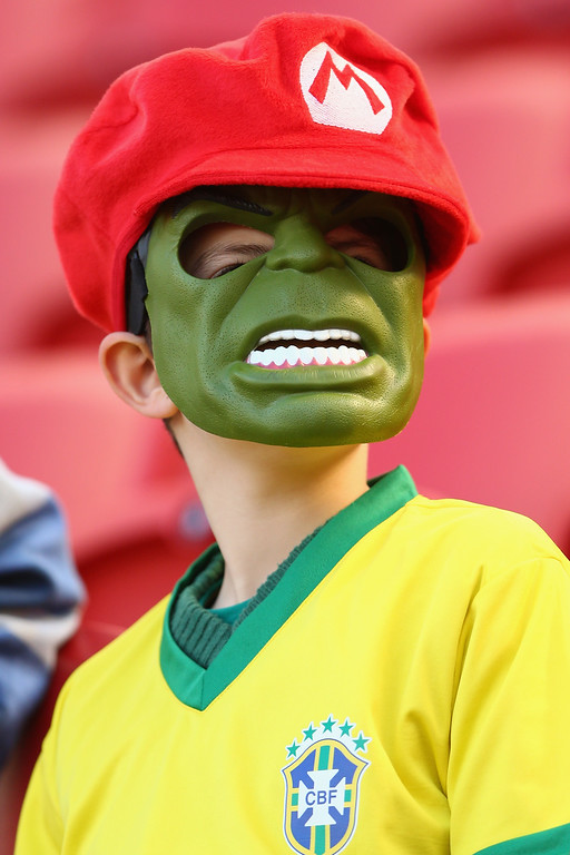 . A soccer fan wears a hulk mask ahead of the 2014 FIFA World Cup Brazil Group B match between Australia and Netherlands at Estadio Beira-Rio on June 18, 2014 in Porto Alegre, Brazil.  (Photo by Cameron Spencer/Getty Images)