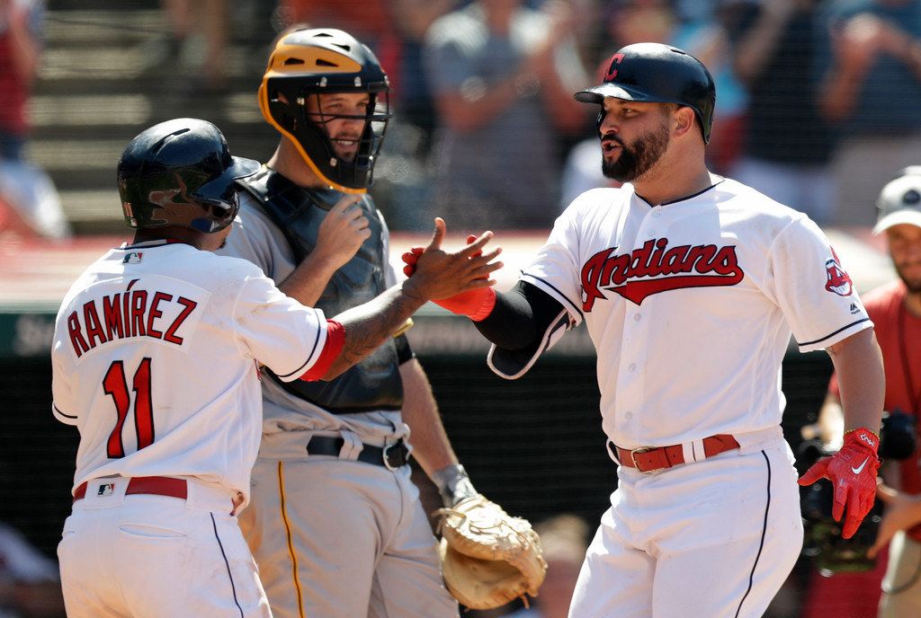 . Cleveland Indians\' Yonder Alonso, right, is congratulated by Jose Ramirez after Alonso hit a two-run home run in the eighth inning of a baseball game against the Pittsburgh Pirates, Wednesday, July 25, 2018, in Cleveland. The Indians won 4-0. (AP Photo/Tony Dejak)