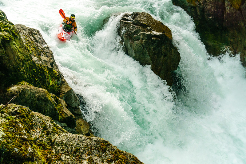 Unknown paddler sets up for the right line on the Upper Cheakamus waterfall near Whistler, British Columbia.