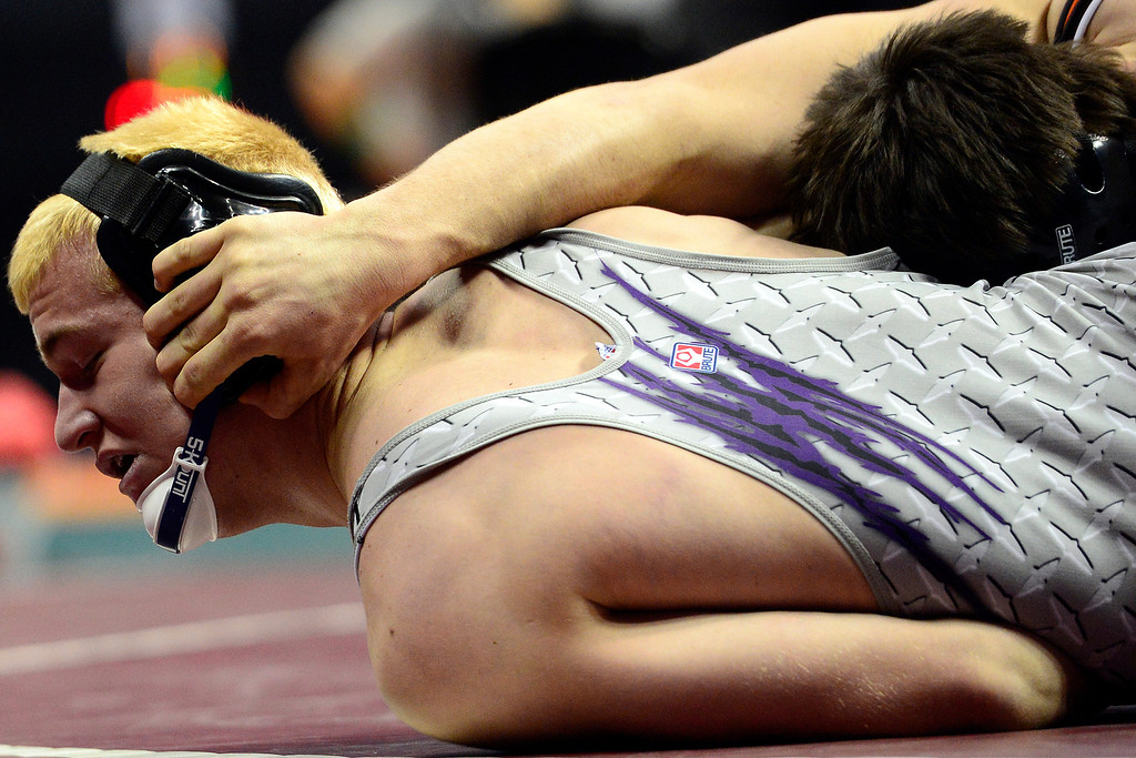 . DENVER, CO - FEBRUARY 23: Garrett Walker of Wiggins earns an 18-3 tech fall win against Mitch VanDuran in the class 2A 18final during the Colorado State High School Wrestling Championships. The state\'s top wrestlers squared off in four classes in front of a near-capacity crowd at the Pepsi Center. (Photo by AAron Ontiveroz/The Denver Post)
