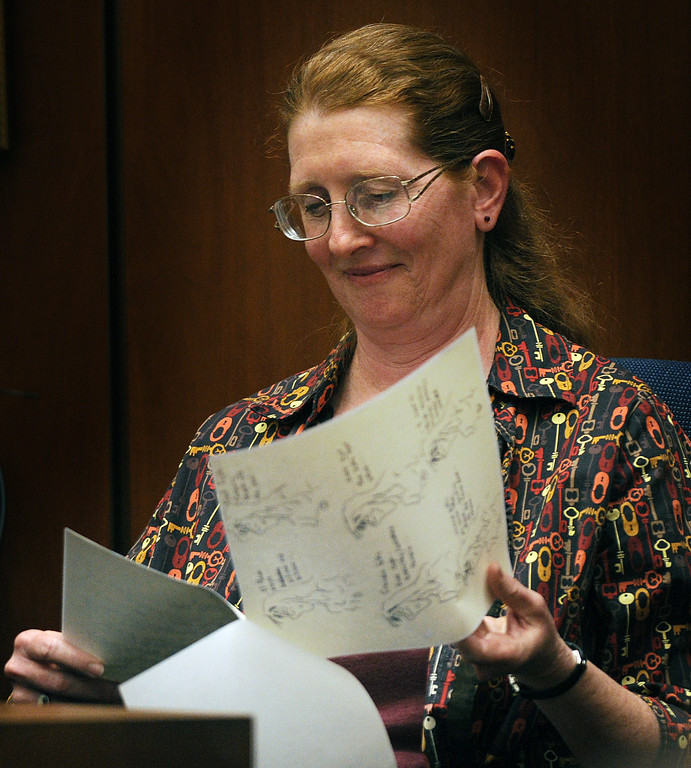 . Susan Coffman, a longtime friend of Linda Sohus identifies drawings and notes that Linda Sohus took during a party they attended, as she testifies in the Christian Karl Gerhartsreiter, murder trial at Clara Shortridge Foltz Criminal Justice Center in Los Angeles Monday, March 25, 2013.  A prosecutor told jurors Monday he will prove a cold-case murder allegation against the German immigrant who spent years moving through U.S. society under a series of aliases, most notoriously posing as a member of the fabled Rockefeller family. He has pleaded not guilty to the killing of John Sohus, 27, who disappeared with his wife, Linda, in 1985 while Gerhartsreiter, using an alias was a guest cottage tenant at the home of Sohus\' mother, where the couple lived.(Photo by Walter Mancini, SGVN)