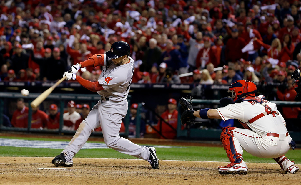 . Boston Red Sox\'s Daniel Nava hits into a fielders choice during the eighth inning of Game 3 of baseball\'s World Series against the St. Louis Cardinals Saturday, Oct. 26, 2013, in St. Louis. Jacoby Ellsbury scored on the fields choice. (AP Photo/Matt Slocum)