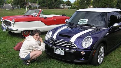 Wendy is taking a close look at our MINI's driving lights. Notice Minnie Mouse's dream car in the background. It is a Nash Metropolitan, built by Austin in England.