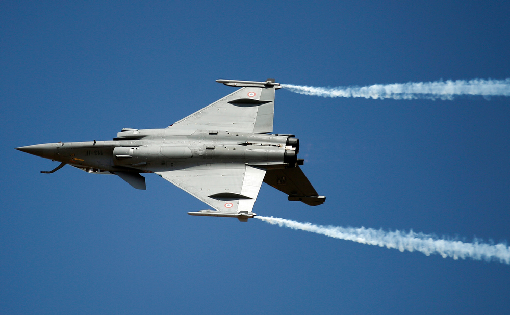 Description of . A French twin-engine Rafale fighter aircraft performs on the opening of the Aero India 2013 at Yelahanka air base in Bangalore, India, Wednesday, Feb. 6, 2013. More than 600 aviation companies along with delegations from 78 countries are participating in the five-day event that started Wednesday. (AP Photo/Aijaz Rahi)