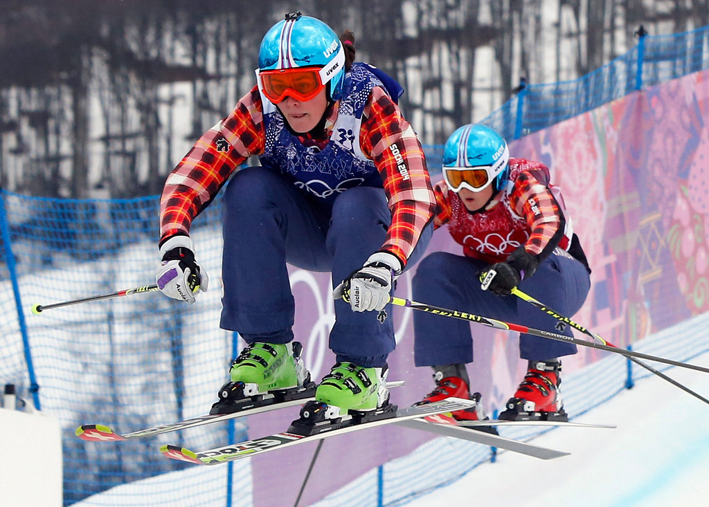 . Canada\'s Marielle Thompson leads compatriot Kelsey Serwa in the women\'s ski cross final at the Rosa Khutor Extreme Park, at the 2014 Winter Olympics, Friday, Feb. 21, 2014, in Krasnaya Polyana, Russia. (AP Photo/Sergei Grits)