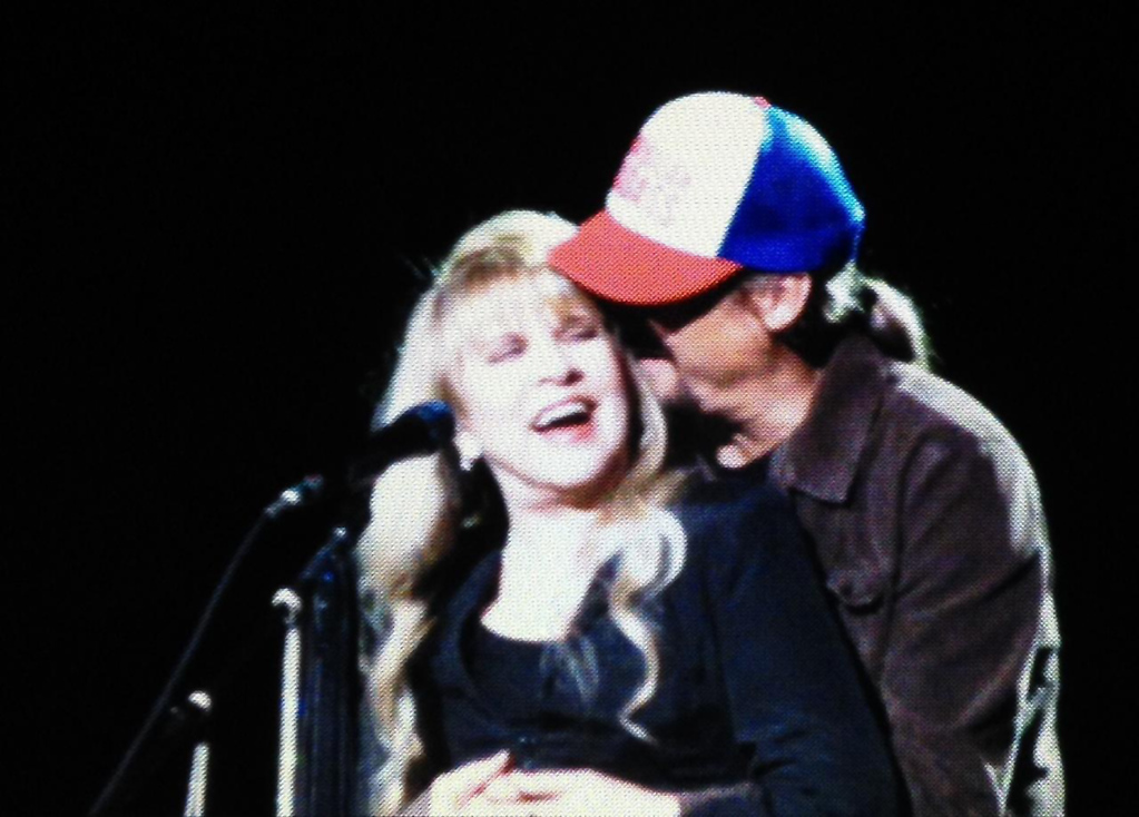 . Kid Rock surprised Stevie Nicks with a hug and kiss on stage at The Palace of Auburn Hills on Wednesday, Oct. 22, 2014. Photo by Paul Barker