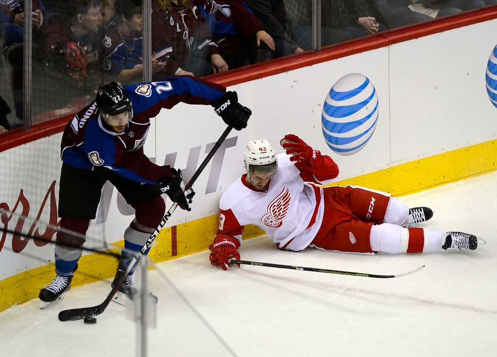 . DENVER, CO - February 5: Colorado Avalanche defenseman Zach Redmond (22) skates away after getting possession from Detroit Red Wings center Darren Helm (43) during the second period Thursday, February 5, 2015 at the Pepsi Center in Denver, Colorado. (Photo By Brent Lewis/The Denver Post)