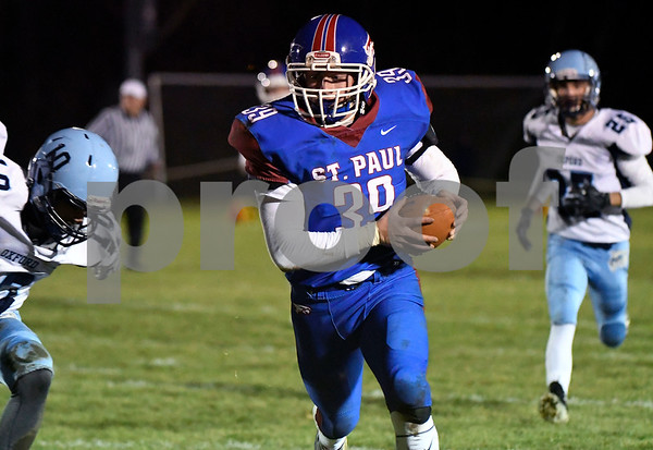 11/22/2017 Mike Orazzi | Staff St. Paul's Quentin Conner (39) during Wednesday night's football game in Bristol.