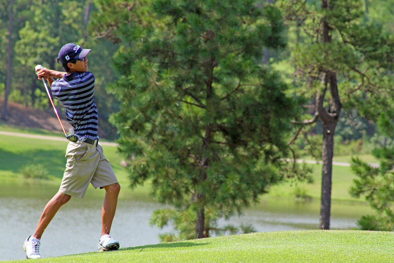 Michael Kim of Del Mar, CA sends a hybrid towards the green and starts to chase after it during the second round of stroke play at the 2013 Western Amateur in Roland, AR. (WGA Photo/Ian Yelton)