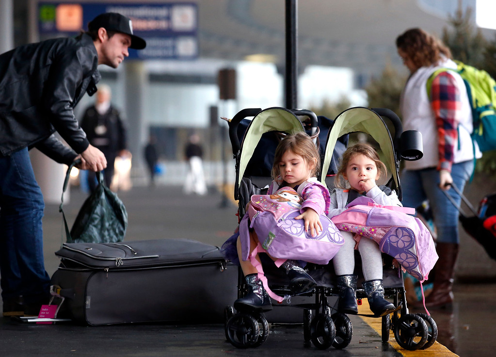 . Travelers arrive at O\'Hare International Airport for holiday traveling in Chicago, Wednesday, Nov. 23, 2016. While driving remains the most popular form of transportation Thanksgiving travelers take, AAA expects just under 4 million people to fly to their holiday destinations. (AP Photo/Nam Y. Huh)