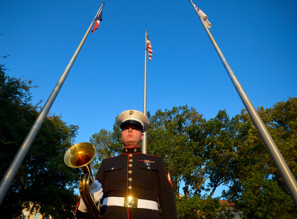 . Marine veteran Andrew Lahey waits for 8:03 a.m. at the flagpole on the TCU campus where he will play Taps to honor the victims of 9/11 on Wednesday, Sept. 11, 2013 in Fort Worth.  Americans marked the 12th anniversary of the Sept. 11 terrorist attacks on Wednesday with the reading of the names, moments of silence and serene music that have become tradition.  At a morning ceremony on the 2-year-old memorial plaza at the site of the World Trade Center, relatives recited the names of the nearly 3,000 people who died when hijacked jets crashed into the twin towers and the Pentagon and near Shanksville, Pa. They also recognized the victims of the 1993 trade center bombing.  (AP Photo/The Fort Worth Star-Telegram, Max Faulkner)