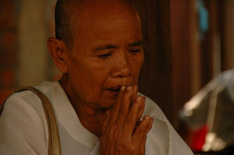 Elderly Man Praying - Battambang, Cambodia