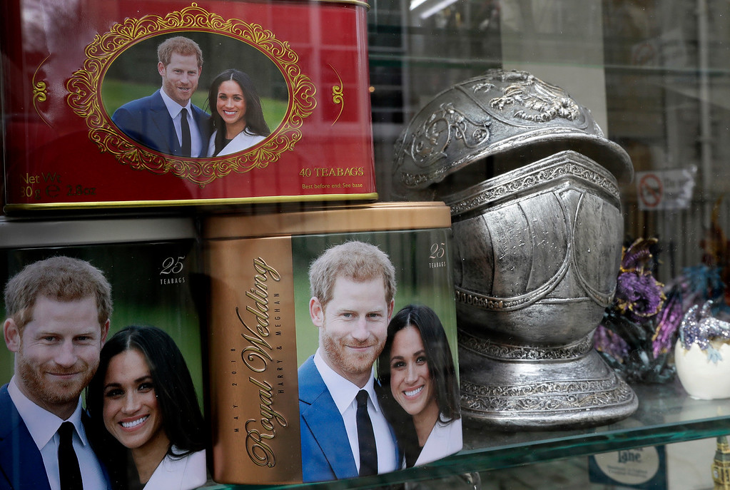 . Memorabilia with a photograph the image of Britain\'s Prince Harry and Meghan Markle are displayed for sale in a shop window in Windsor, England, Thursday, March 29, 2018. Britain\'s Prince Harry will marry Meghan Markle in Windsor on May 19. (AP Photo/Kirsty Wigglesworth)