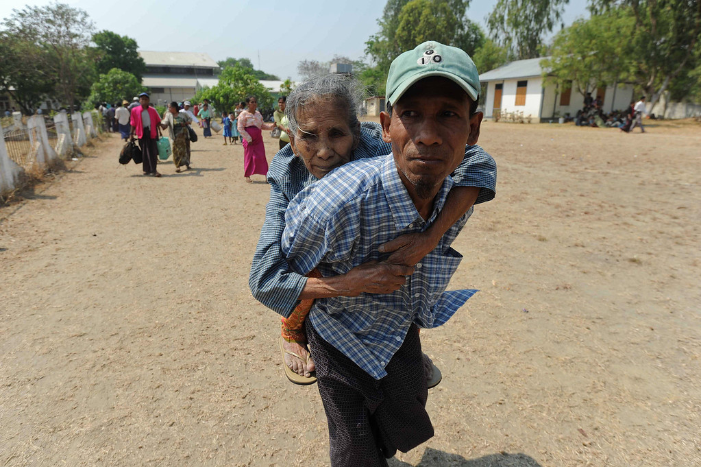 . An elderly Muslim resident is carried into a temporary relief camp after her evacuation from riot-hit Meiktila, central Myanmar on March 22, 2013.   AFP PHOTO/ Soe Than WIN/AFP/Getty Images