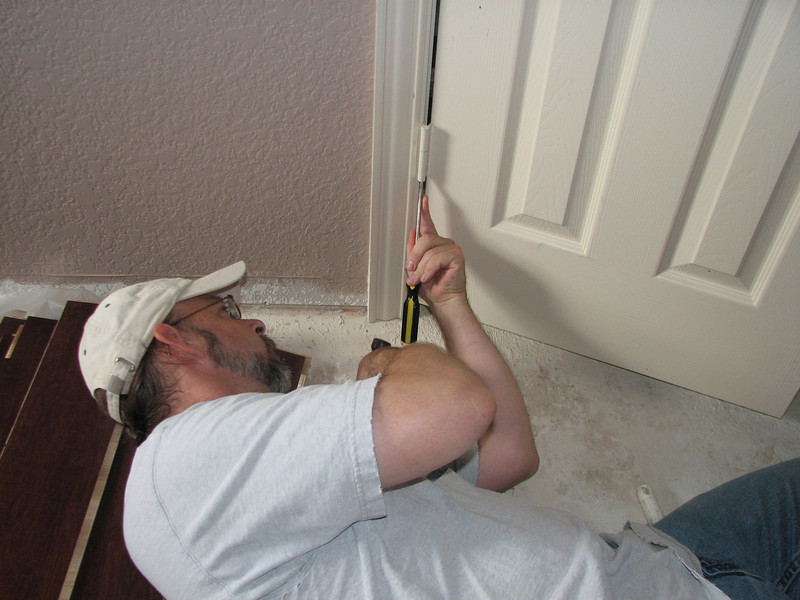 Taking the hinges off of the closet door.