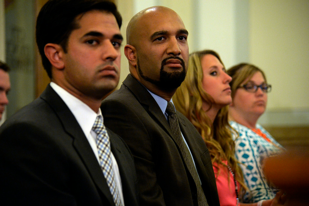 . DENVER, CO - AUGUST 04: Council for Jamal Hunter Arash Jahanian (left) and Qusair Mohamedbhai listen as the city council speaks on their settlement. The Denver city council voted 10 to 1 in favor of a $3.25 million settlement in the Jamal Hunter jail abuse case on Monday, August 4, 2014. (Photo by AAron Ontiveroz/The Denver Post)