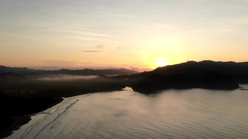 Sunrise time lapse over the beach with the clouds over the water in Costa Rica