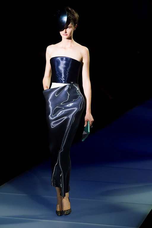 """. A model walks the runway during Giorgio Armani\'s \""""One Night Only New Yorkî fashion show on Thursday, Oct. 24, 2013 in New York. (Photo by Charles Sykes/Invision/AP)"""