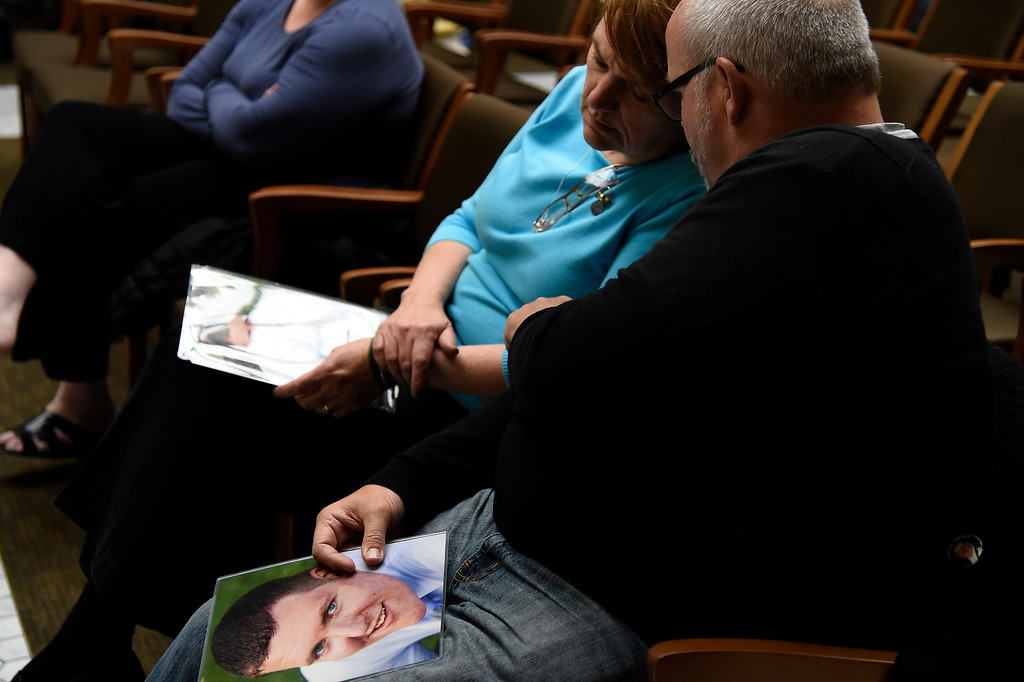 . DENVER, CO. - March 09, 2015: Tom comforts his wife Terry Sullivan after testifying with a photo of their son, Alex Sullivan, who died during the theater shooting\'s in Aurora celebrating his 27th birthday as the Senate Judiciary Committee take\'s up Senate Bill 175, by Republican Senators. John Cooke of Greeley and Chris Holbert of Parker at the State Capital; the bill repeals ammunition magazine limits imposed by the 2013 legislature. March 09, 2015 Denver, CO (Photo By Joe Amon/The Denver Post)