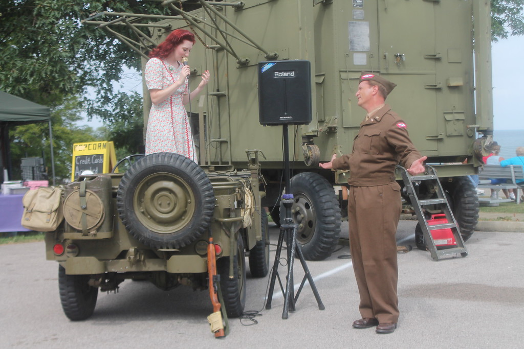 . Jennelle Gilreath, St. Louis,  Missouri and Luke Sharrett, Louisville Kentucky, perform as solo reenactors representing the USO during D-Day Conneaut on Aug. 17. Kristi Garabrandt - The News-Herald