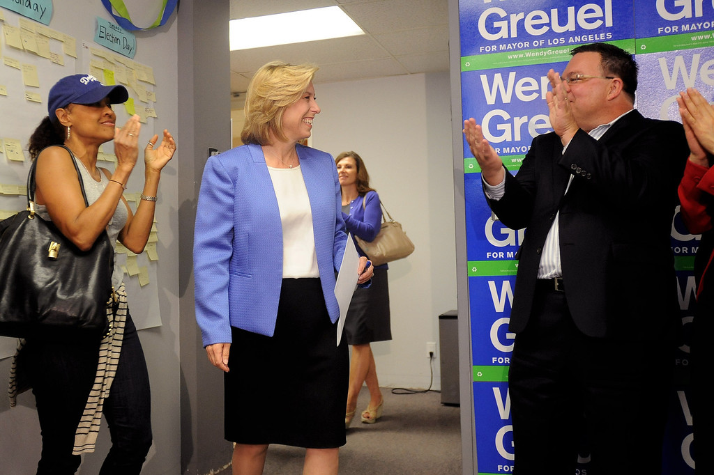 . Supporters applaud Wendy Greuel as she arrives for a press conference at her Van Nuys field office May 22, 2013.  Greuel was defeated by Eric Garcetti in a mayoral runoff Tuesday in Los Angeles.(Andy Holzman/Staff Photographer)