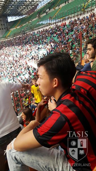 Del Sole take in a soccer game in Milan.