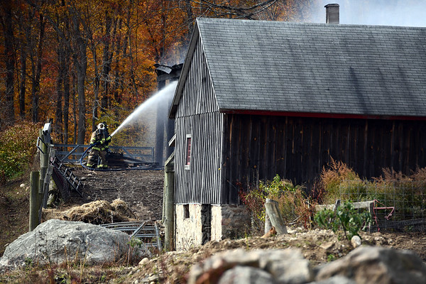 10/25/2019 Mike Orazzi | Staff The scene of a fire that destroyed a barn on Hill Road in Harwinton on Friday afternoon. Fire departments from multiple communities responded with mutual aid, at least one firefighter was taken from the scene by EMS.