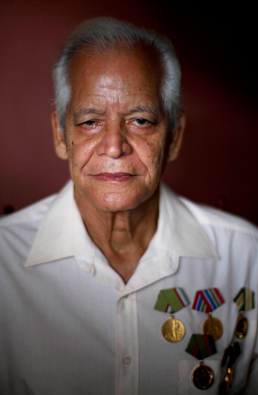 """. Claudio Rodriguez Contreras, 71, a veteran of the Cuban revolution, poses for a photo at his home in Havana, Cuba on Saturday, June 15, 2013. When asked: As you grow older, what are you most afraid of and what is the biggest problem facing the elderly in your country? Contreras said, \""""Cuban elderly have no biggest fears of old age, as our revolutionary government within its means helps us with minimal requirements - a pension, free medical care, food, home, and keeps us active in society. The problem at my old age is that because of the embargo that Cuba receives, our country can not develop as it should and we can not enjoy seeing the dreams made for our children.\"""" (AP Photo/Ramon Espinosa)"""