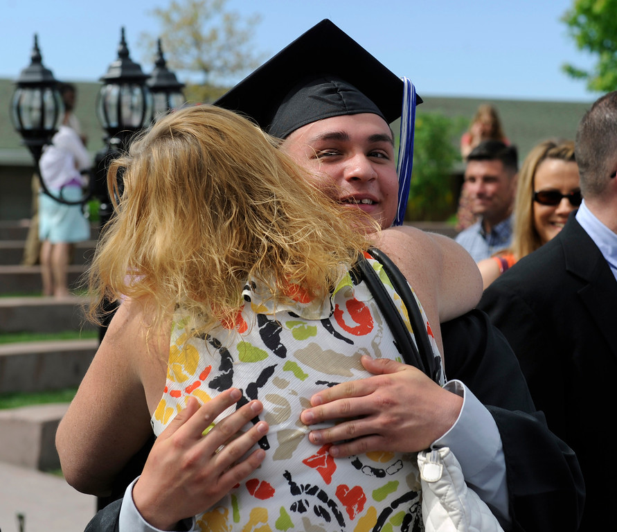 . Graduate Ryan Ruybal gets a congratulatory hug from mom Michelle Bradshaw. (Photo By Kathryn Scott Osler/The Denver Post)
