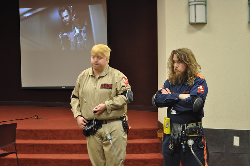 Ghost Busters taking questions and the movie playing behind.jpg