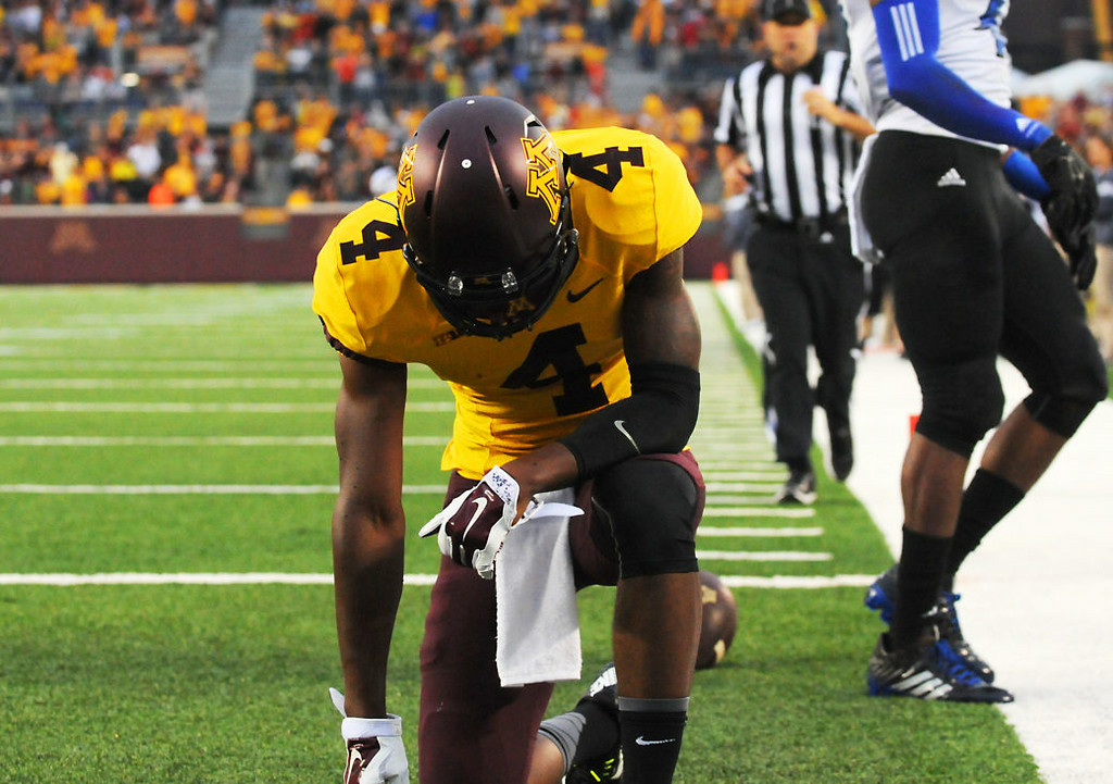 . Minnesota wide receiver Donovahn Jones takes a knee after a 36-yard reception for a touchdown in the second quarter.  (Pioneer Press: John Autey)